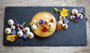 Tarte au citron blow torch meringue with edible flower